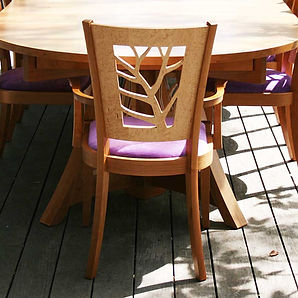 The Giving Chair, a hand made dining chair with a tree branch design
