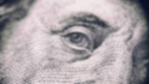 Close up of Benjamin Franklin on US dollar