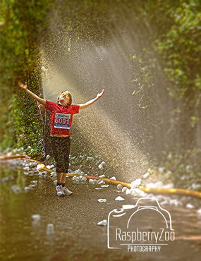 Fun Run Boy in Water Spray