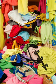 Close up on a big pile of clothes and ac