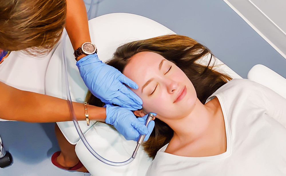 aerial view of women in spa chair receiving a med-tech facial