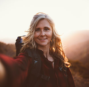 Happy-senior-woman-hiker-taking-a-selfie