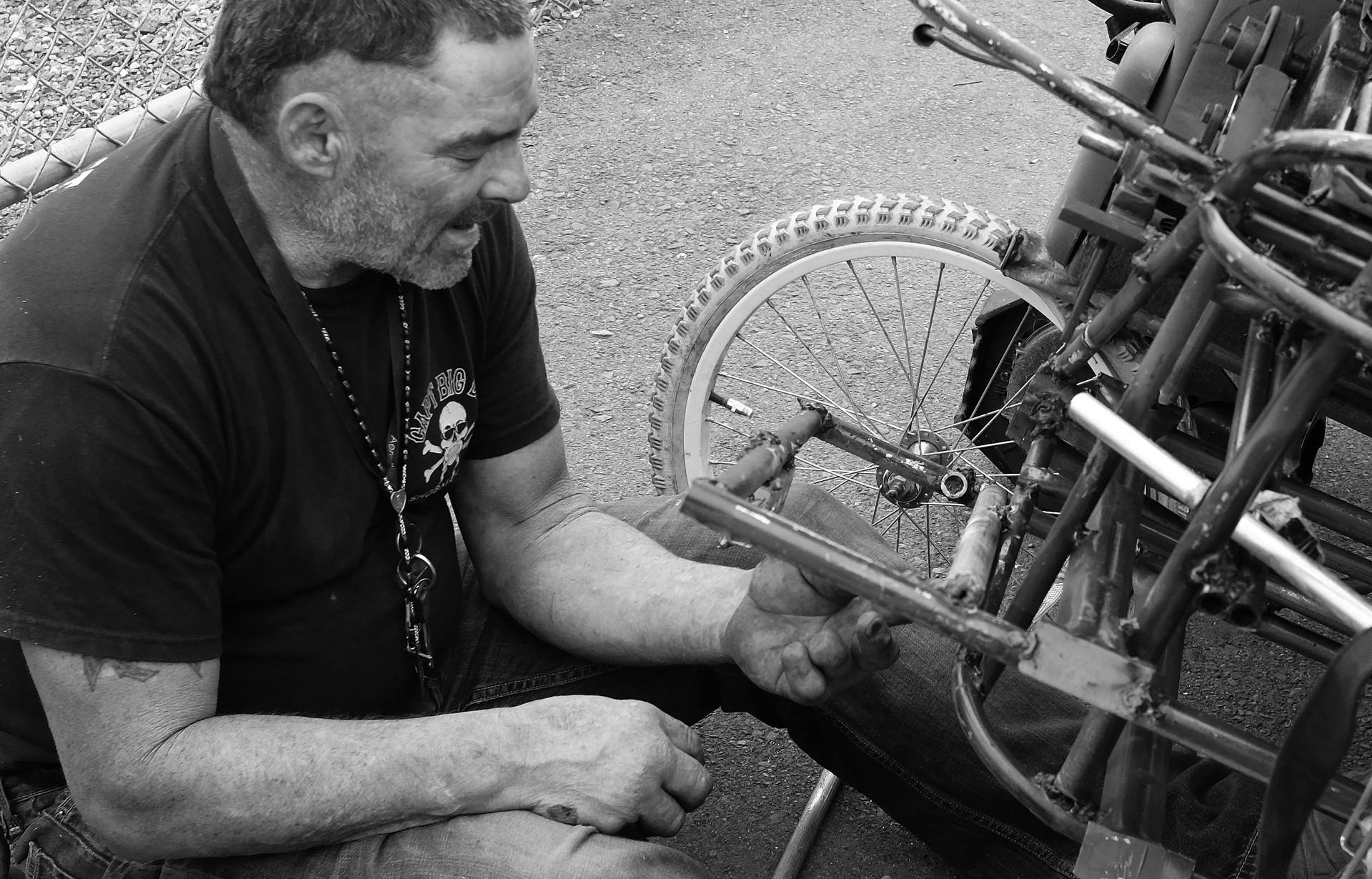 22_Guy Working on Bike.jpg