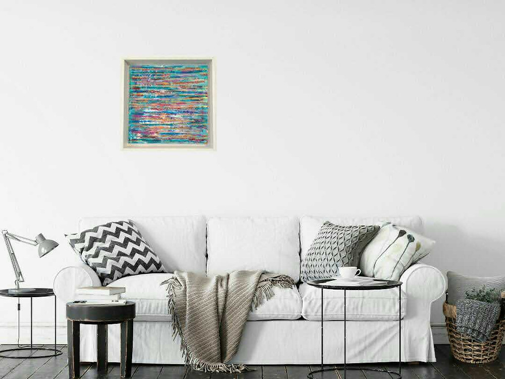 an image of a new painting hung in a living room