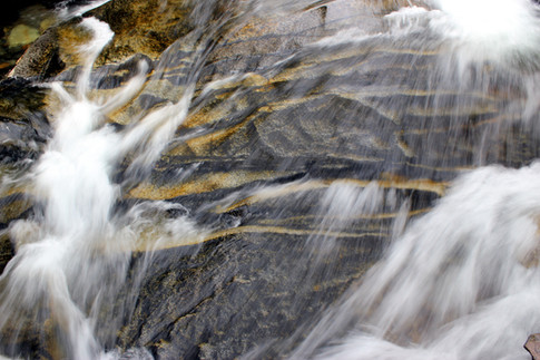 Waterfall rolling down a vertical rock face