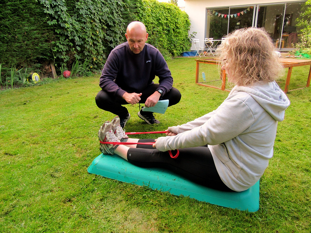 Strengthening an ankle joint with a resistance band at Graham Fit Personal Training
