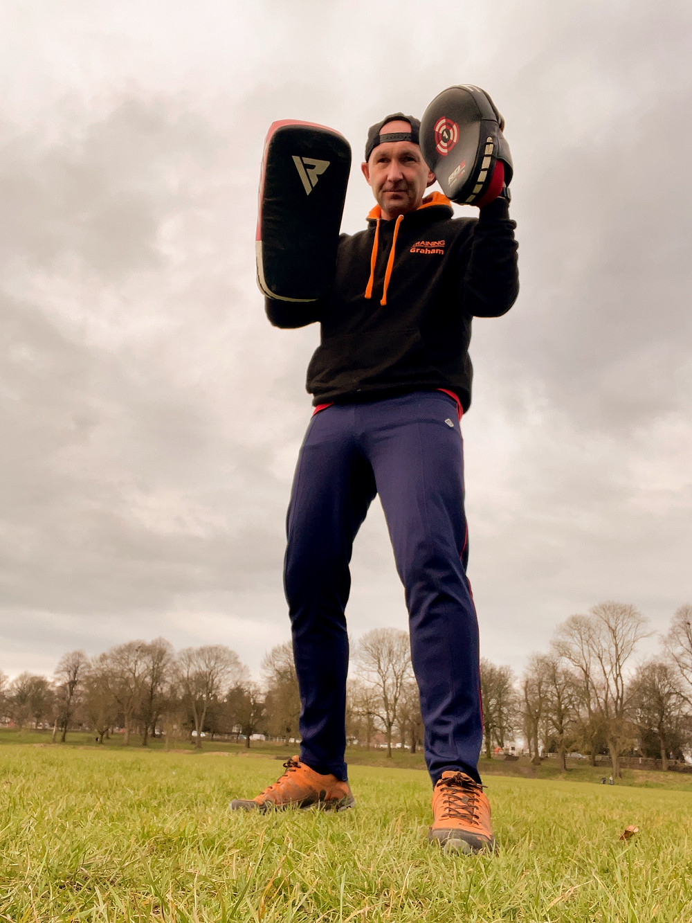 Graham Kavanagh holding boxing pads