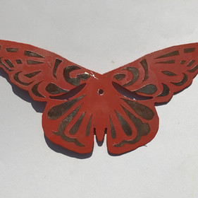 STEEL BUTTERFLY: One of the 300 butterflies that were installed on Unidos. The butterflies are cut from steel with rusted and aerosol patterns.
