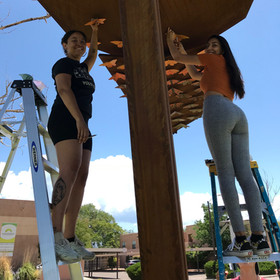 BUTTEFLY INSTALLATION: Apprentices and I installing butterflies on Unidos.