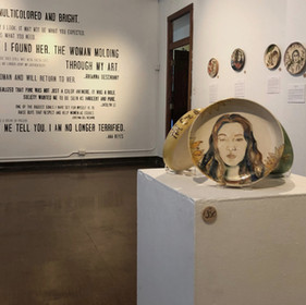 """QUOTE MURAL: On the north wall of the gallery, gretting viewers as they walk in, we painted a """"Quote Mural."""" These words were pulled from the narrativs of women who shared their stroy."""