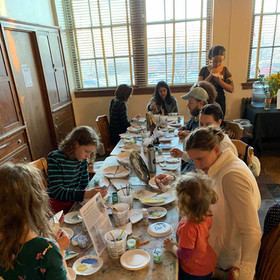 GLAZING WORKSHOP: Workshop attendees glazing pieces of the Matriarch Installation.