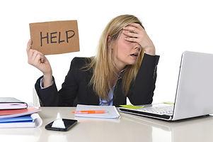 Help Sign Woman at Desk.jpeg