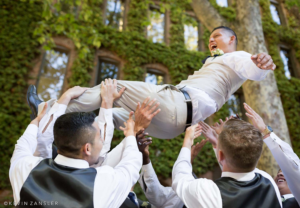 This groom is so happy he's literally flying!