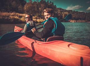 Happy couple on a kayaks.jpg
