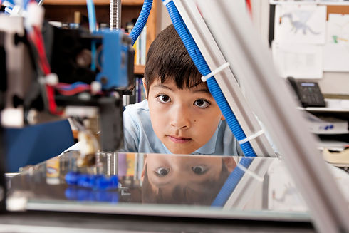 boy-watches-3d-printer-getty.jpg