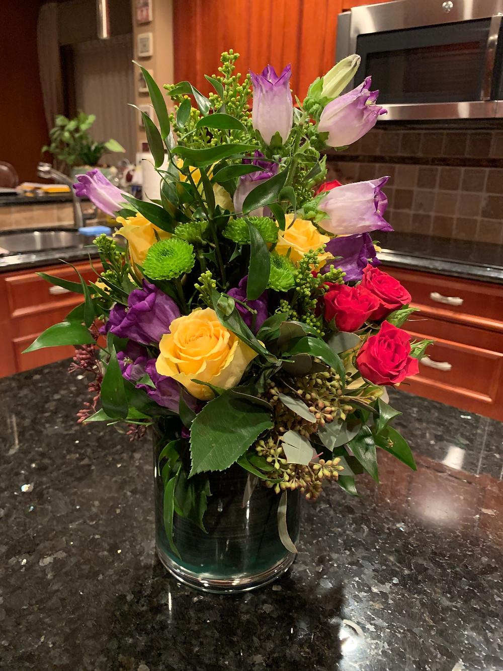 empty nesters finally, flower centerpiece, roses