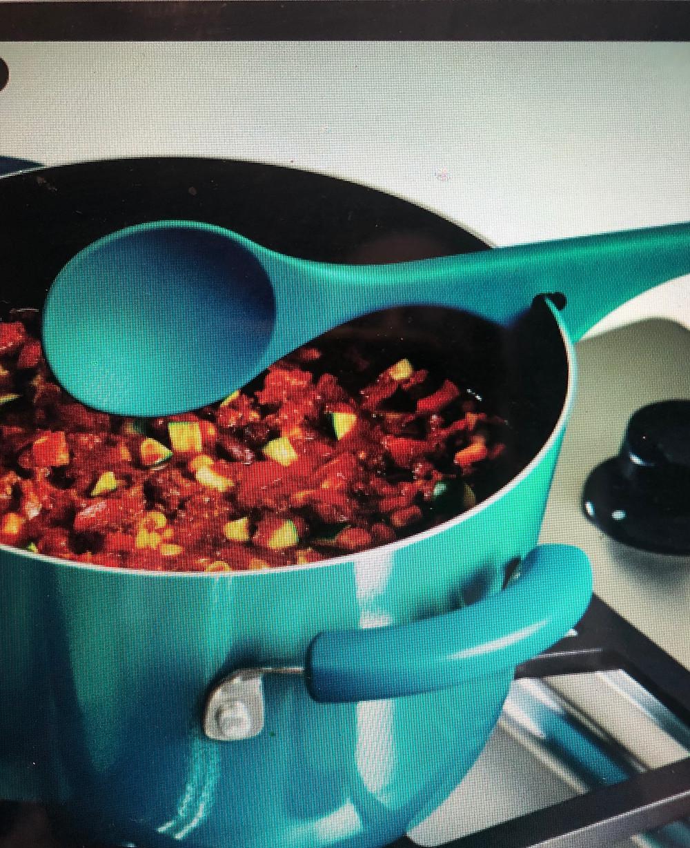 Rachel Ray Spoon that cradles the pot.