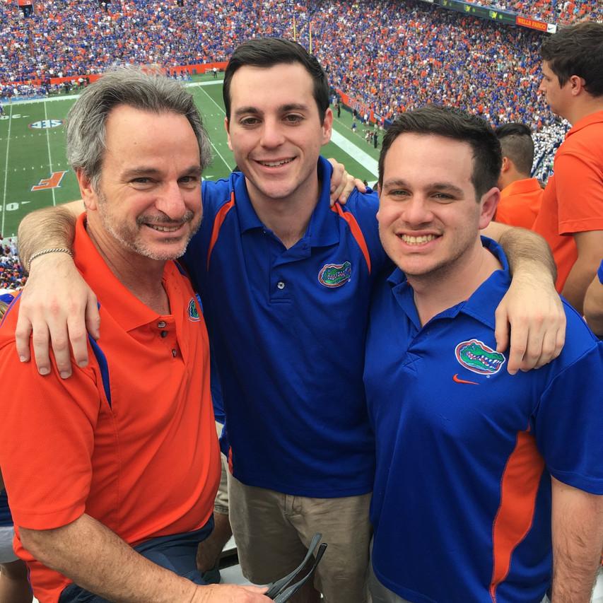 Hacker men at University of Florida football game, boys are alumni now, empty nesters finally