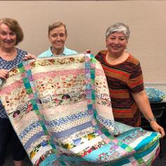 Quilt Guild donates quilts to Victoria Public Library