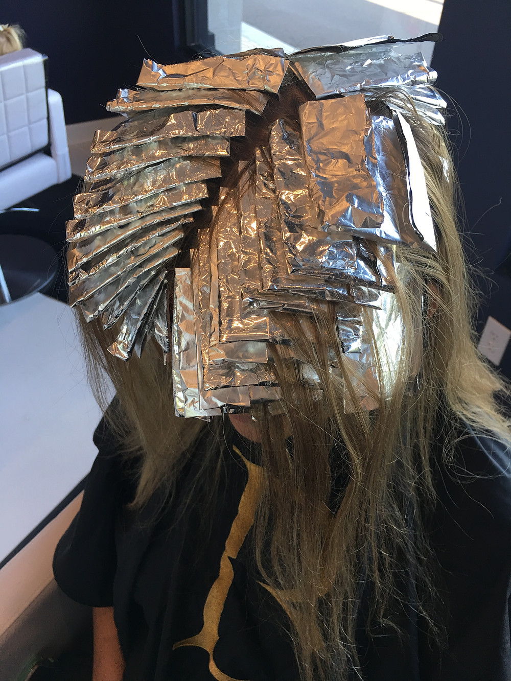 A mixed foil application  with 2 back to back bleach foils around her hairline, and every other foil alternating color and bleach