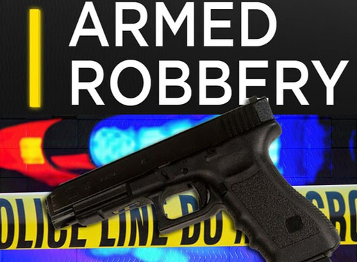 Armed robber ties up employee at check cashing business in Harlan - suspect still on the run