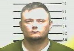 After pouring gas on a building, a Middlesboro man threatens to burn it with owners inside