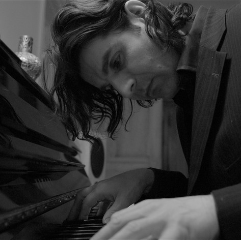 Piano player with long hair...