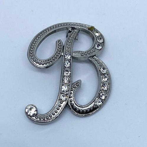 """Crystal studded silver """"B"""" boutonnière"""
