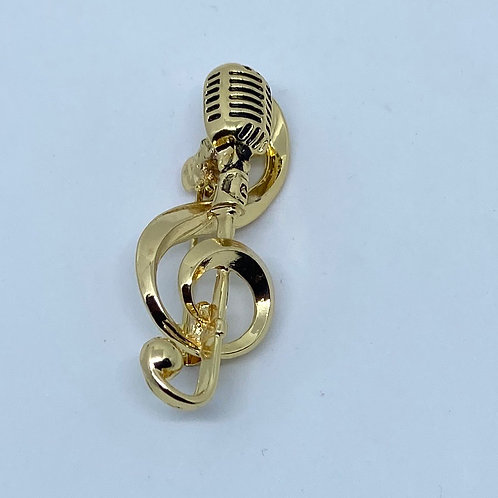 Golden music treble clef with microphone