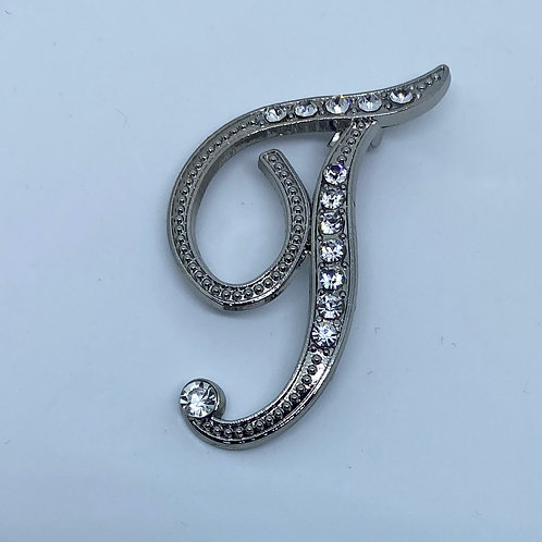 """Crystal studded silver """"T"""""""