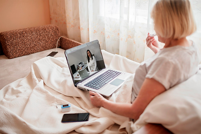 old-woman-bed-looking-screen-laptop-consulting-with-doctor-online-home-telehealth-services