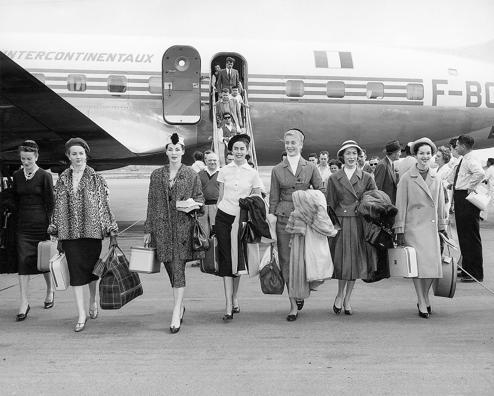 Christian Dior models arrive in Australia in November 1957 for the presentation of the autumn/winter 1957 haute couture collection (Christian Dior's last collection) at Myer Mural Hall, Melbourne. Photograph: National Gallery of Victoria