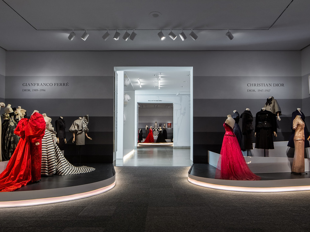 View looks by each of Dior's artistic directors. Photo by James Florio, Dallas Museum of Art