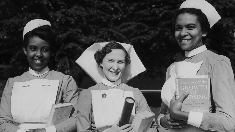 Pictured: Prize-winning student nurses at the Dreadnought Seaman's Hospital, Greenwich, London, 29th June 1954. Left to right: C.S. Ramsay of Jamaica, C. Bishop of Chelsea and J.E. Samuel of Trinidad. (Photo by Meager/Fox Photos/Hulton Archive/Getty Images)
