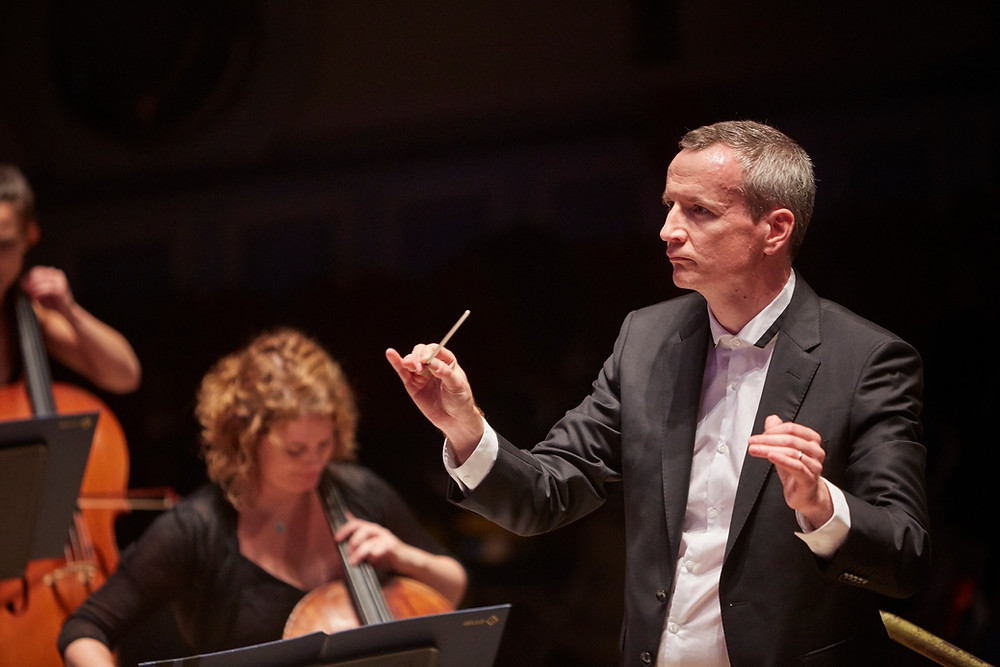 Garry Walker conducting the Orchestra of Opera North. Pic: Justin Slee