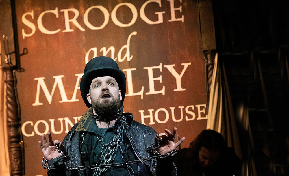 A chained Matthew Ganley as Jacob Marley in A Christmas Carol at Storyhouse, Chester
