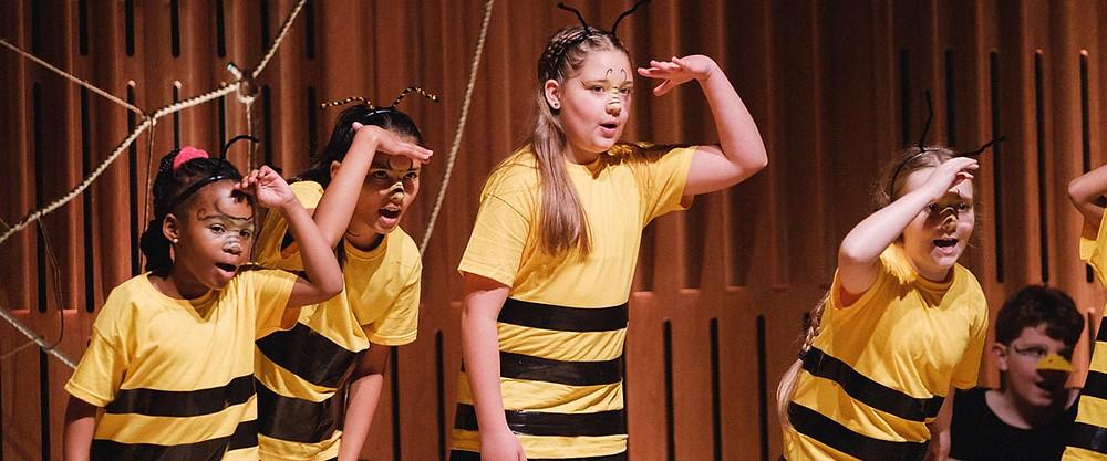 Opera North Children's Chorus perform The Spiders' Revenge. Pic: Tom Arber