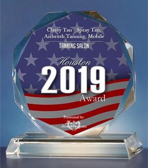 Classy Tan Receives Award