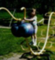 Megan on odd playground thing.jpg