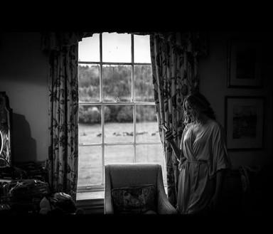 Bridal suite shot, bay window. Lee and Michaels wedding at Walcot Hall, Shropshire. Wedding photographer Birmingham.