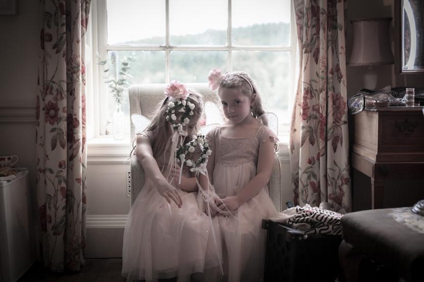 Flower Girls in the window at Walcot Hall, Shropshire. Wedding photographer Birmingham, West Midlands.