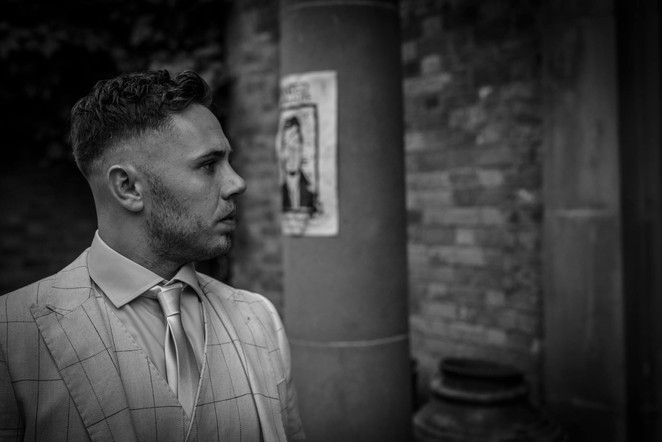 Photograph of the groom at Walcot Hall, Shropshire. Black and White Wedding photographer Birmingham, West Midlands.
