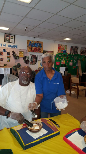 At Cooking Group, SDP Staff assists participants with preparing healthy snacks & beverages