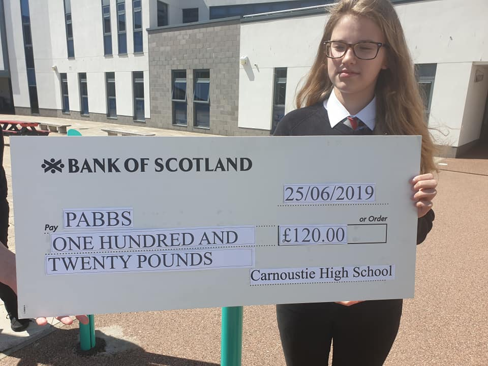Carnoustie Pupil holding cheque to PABSS