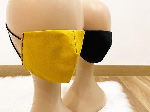 Mascarilla reversible amarilla y negra