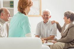 seniors-sitting-with-nurse-PRMTAS3