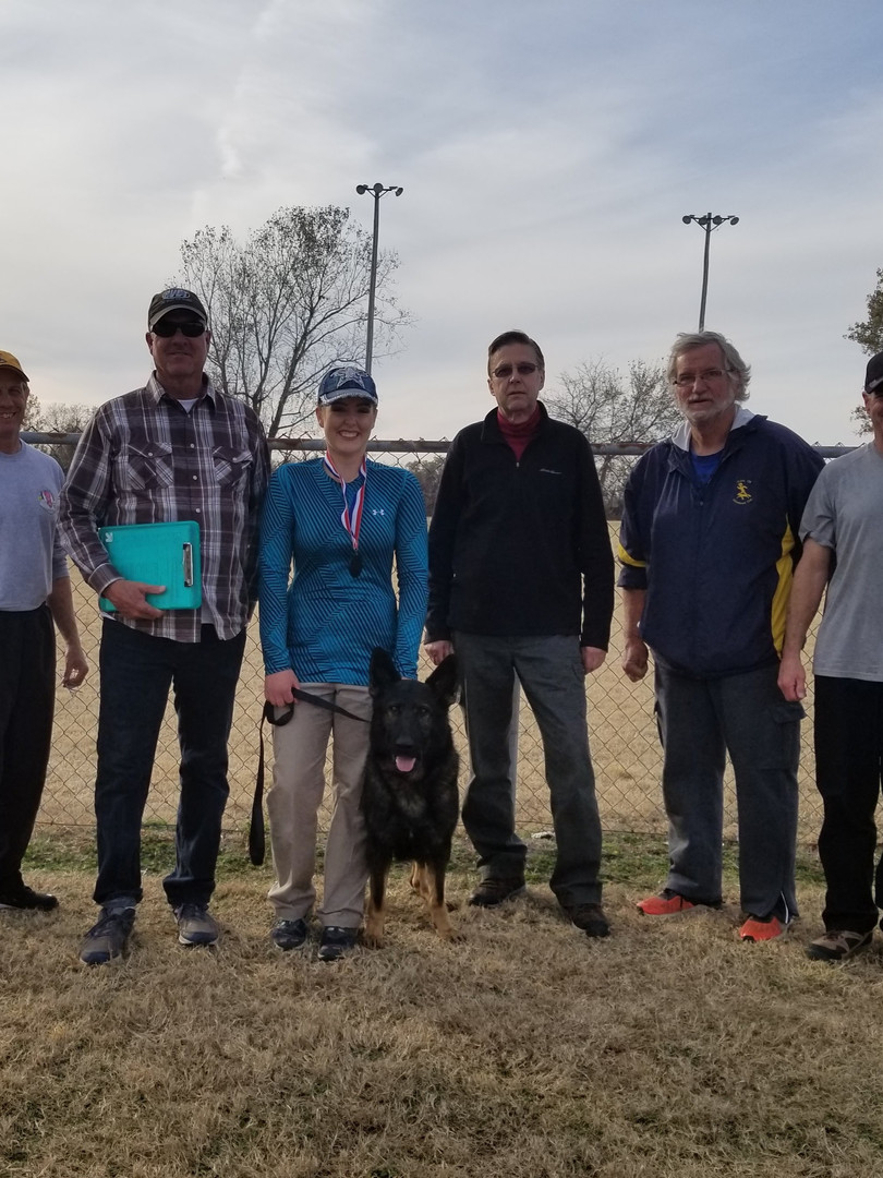 BFK9 Trainer, Megan Clouse, (Rone) Platon z Jirkova Dvora CGC, BHx2, IGP1, and Tulsa Schutzhund Club members with Trial Judges