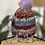 Thumbnail: Peacock pom knit hat