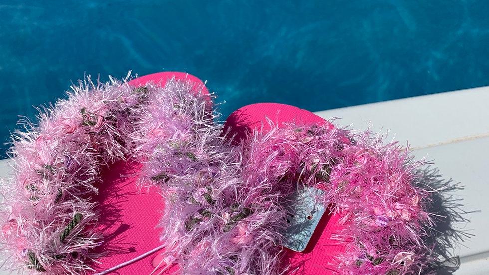 Hot pink flip flops