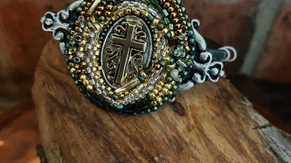 Gold beaded cross bracelet